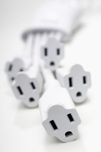 Closeup of white power extension cords isolated over white background