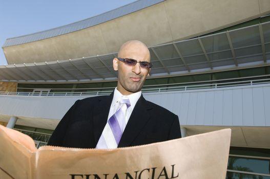Businessman Reading A Financial Newspaper