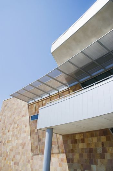 Modern commercial building against blue sky