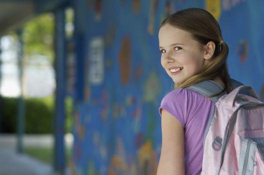 School girl outside school