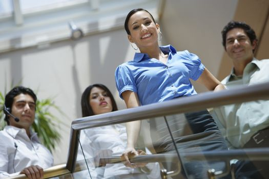 Business colleagues standing on stairs