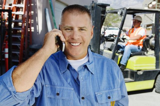Workman Talking on a Cell Phone