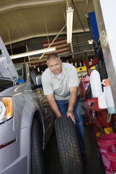 Auto Mechanic Changing a Tire