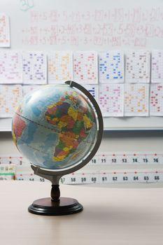 Globe on desk in elementary classroom