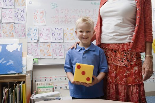 Teacher with Little Boy Holding Large Die