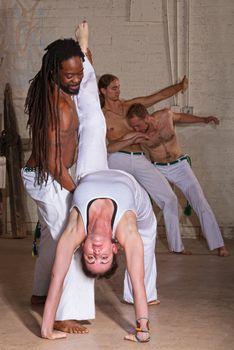 Capoeira Holding Student Backward