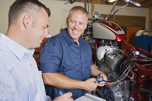 Two mechanics at work