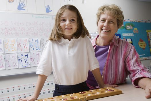 Teacher and Schoolgirl with Counting Tray