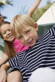 Little Kids on a Slide