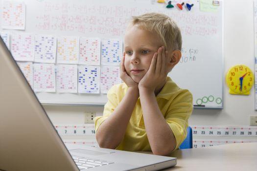 Schoolboy Using a Laptop
