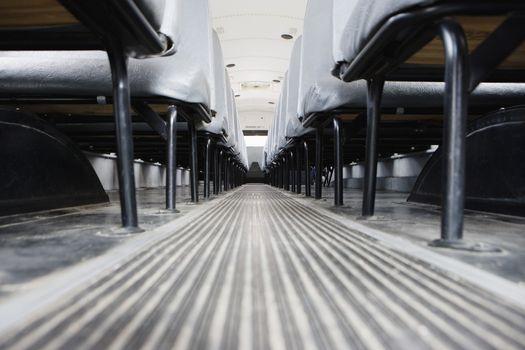 Aisle between seats in empty school bus