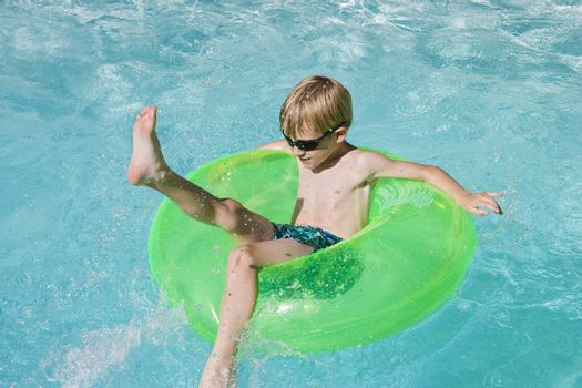 Boy on Float Tube in Swimming Pool