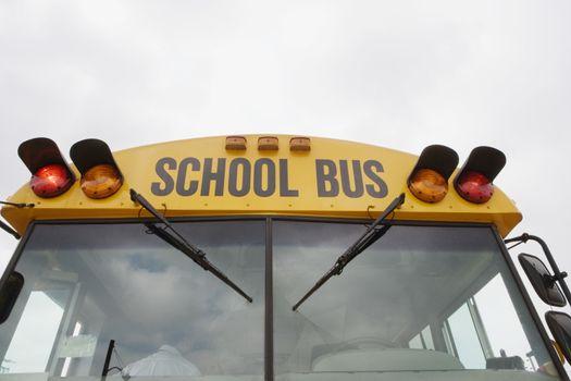 Caution lights flashing on school bus