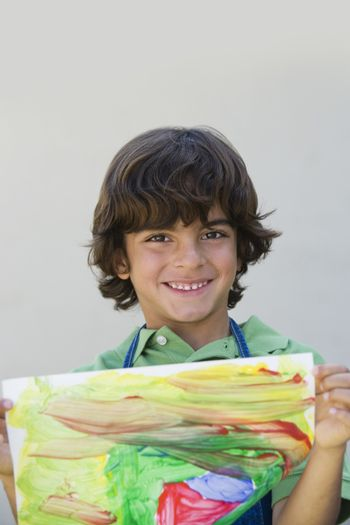 Boy Showing Off Painting
