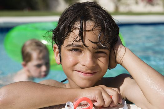 Boy at Edge of Swimming Pool