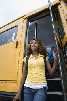 High School Girl Getting Off School Bus