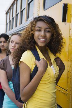 High School Girls Getting On School Bus