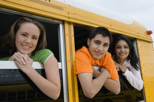 High School Students Looking Out Windows of School bus