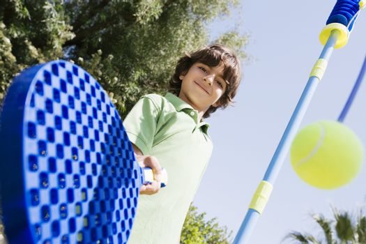 Boy Playing with Paddle and Tethered Ball