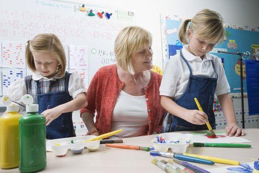 Teacher Watching Students Paint