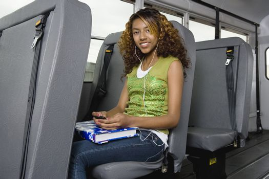 Teenage Girl Listening to MP3 Player on Bus