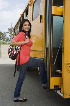 Teenage Girl Getting on School Bus