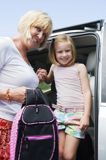 Mother Driving Daughter to School