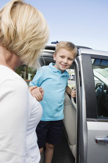 Mother Driving Son to School