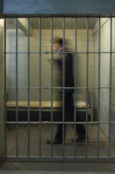 Man walking in prison cell