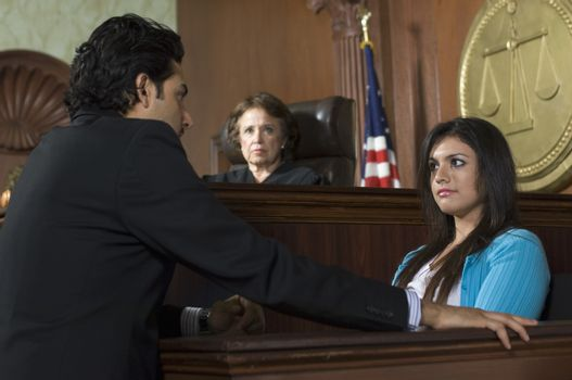 Judge watching prosecution in court