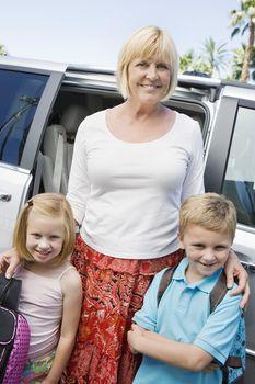 Mother Driving Children to School