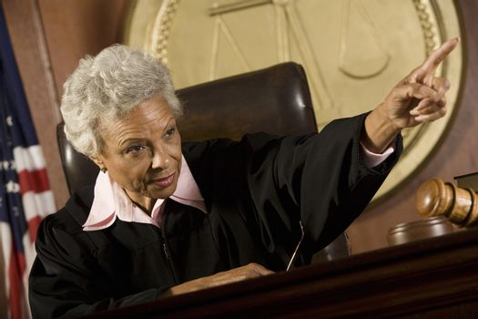 Female judge giving order in court