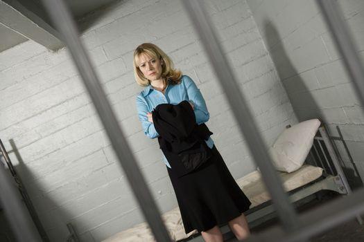 Female criminal behind bars in jail
