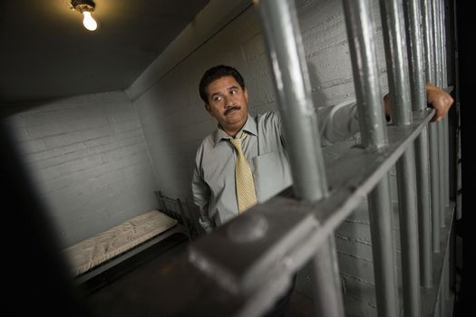 Criminal behind bars in jail