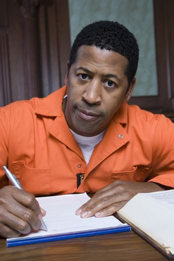 Criminal writing in court portrait