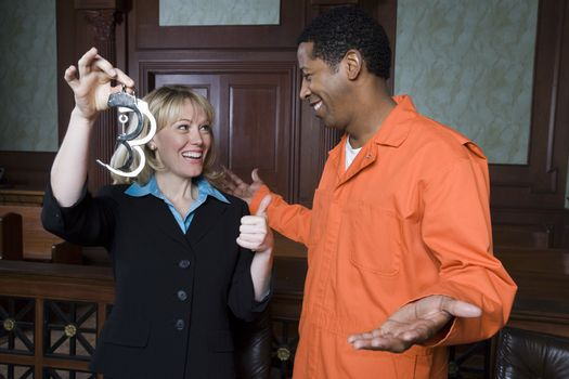 Lawyer and client celebrating in court