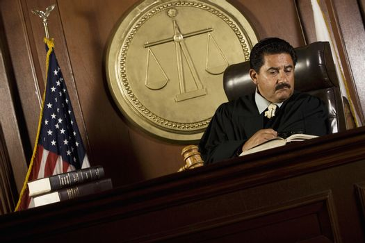 Judge reading in court