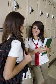 High School Girls Chatting by School Lockers
