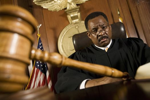 Middle-aged judge gavel in front of him