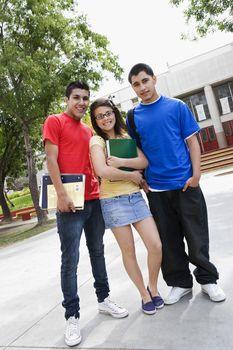 High School Friends Standing in Front of School