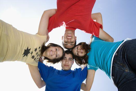 High School Students Huddling