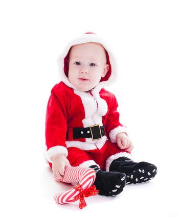 Little Santa boy with  staff isolated on white background