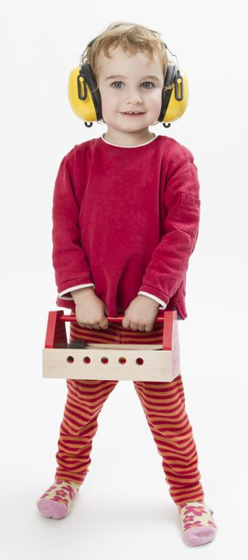 child in red clothing with toolbox and earmuffs. vertical image