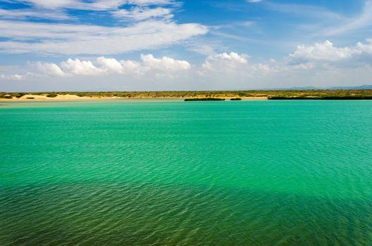 Green sea and blue sky in La Guajira, Colombia