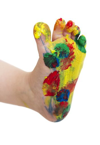 painted feet from young child isolated in white bachground