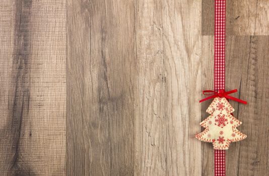 Christmas decoration with wood background, Christmas tree red with ribbon