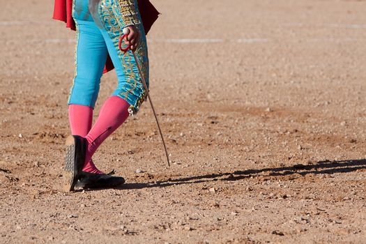 Bullfighting walking on the sand with his sword, Spain