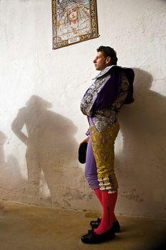The Spanish Bullfighter David Valiente waiting in the alley of the plaza de toros de Jaen, Spain