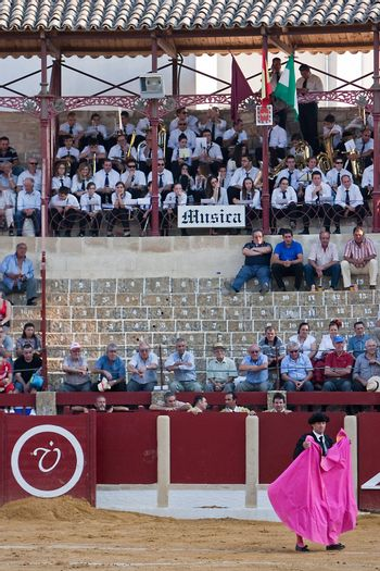 Spectators and music band in a bullfight in Ubeda, province of Jaen, Spain