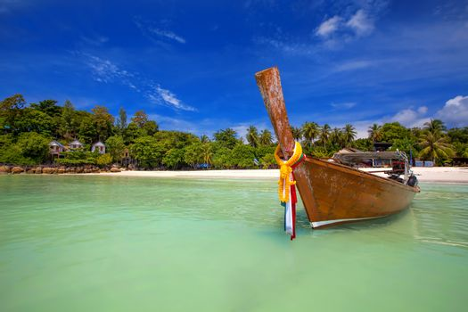 Longtaill boat and turquoise water at tropical beach